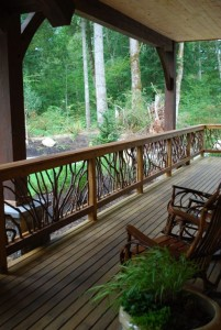 Long timber deck with tables and chairs