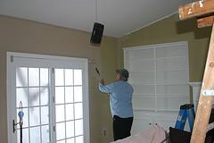 Man repainting a room